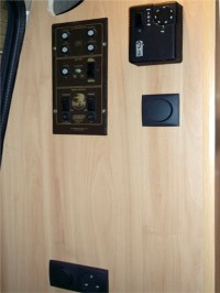 Central heating controls & electric sockets fitted in camper interior  by Céide Campervan Conversions, Co. Donegal, North-West Ireland