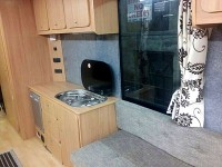Overview of kitchen area with campervan seating fitted by Céide Campervan Conversions, Co. Donegal, North-West Ireland