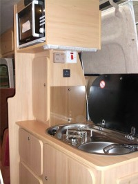 Oven and sink fitted in a camper conversion by Céide Campervan Conversions, Co. Donegal, Ireland