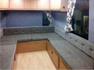 This seating area converts into a 5 berth sleeping area at night, with slide out beds - van conversion by Céide Campervan Conversions, Co. Donegal,  Ireland