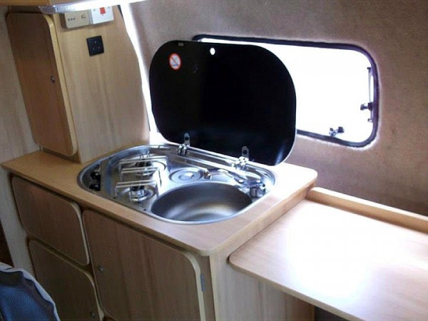 Kitchen sink and cupboard in  campervan conversion by Céide Campervan Conversions, Donegal,  Ireland